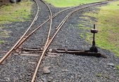 Fragment of the ancient Narrow Gage Railway with an arrow — Stock Photo