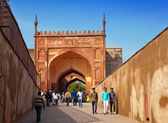AGRA, INDIA - JANUARY 28: A crowd of tourists visit Red Fort Agra on January 28, 2014 in Agra, Uttar Pradesh, India. The fort is the old Mughal Empire capital and a UNESCO World Heritage Site. — Stock Photo