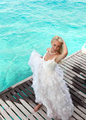 The bride on a wooden platform over the see — Stock Photo