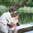 The father asks a fishing tackle from the son too to fish — Stock Photo #42867617