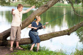 Young people on fishing — Stock Photo