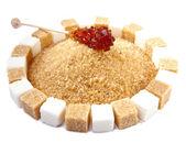 Sugar cube on a heap of granulated sugar — Stock Photo