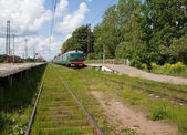 Electric local train at the platform in rural areas — Stock fotografie