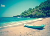 Indonesia. Bali. Traditional national boat on an ocean coast,with a retro effec — Stock Photo