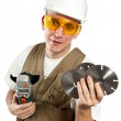 The man, the builder, in goggles and a helmet. — Stock Photo #4765486
