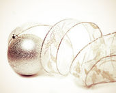 Beautiful silvery New Year's ball and elegant tinsel with a retro effect — Stock Photo