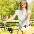 Happy young woman on the bicycle — Stock Photo #13311711