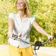 Happy young woman on the bicycle — Stock Photo #13311947