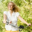 Happy young woman on the bicycle — Stock Photo #13312025