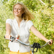 Royalty-Free Stock Photo: Happy young woman on the bicycle