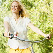 Happy young woman on the bicycle — Stock Photo #13312105