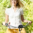 Happy young woman on the bicycle — Stock Photo #13312142
