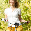Happy young woman on the bicycle — Stock Photo #13312199