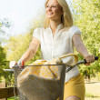 Stock Photo: Happy young woman on the bicycle