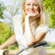 Happy young woman on the bicycle — Stock fotografie