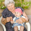 Senior woman with granddaughter — Stock Photo #13492140