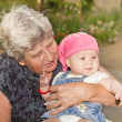 Senior woman with granddaughter — Stock Photo #13492302