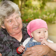 Senior woman with granddaughter — Stock Photo #13492558