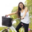 Stock Photo: Happy girl on the bicycle