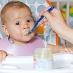 Baby feeding — Stock Photo #13678844