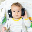 Baby with headphones - Stock Photo