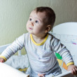 Stock Photo: Cute baby girl in her cot