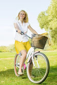 Happy young woman on the bicycle — Stock Photo