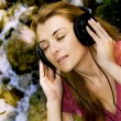 Beautiful girl listen music — Stock Photo #22588713