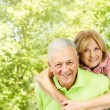 Happy senior man giving piggyback ride — Stock Photo #22588761