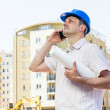 Construction manager holding project — Stock Photo
