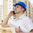 Construction manager holding project — Stock Photo #24750507