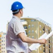 Architect on construction site — Stock Photo #24750621
