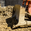 Bulldozer on building site - Stock Photo