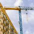 Construction crane with building - Stock Photo