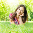 Beautiful smiling young woman relaxing — Stock Photo