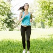 Fitness girl jogging — Stock Photo
