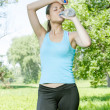 Fitness girl refreshment — Stock Photo