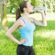 Fitness girl drinking water — Stock Photo #27722469