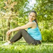 Stock Photo: Happy fitness girl relaxing