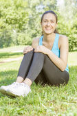 Happy fitness girl relaxing — Stock Photo