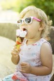 Cute baby girl eating ice cream — Stock Photo