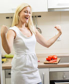 Happy woman in the kitchen — Stock Photo