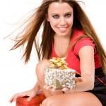 Beautiful shopping girl giving gift box — Stock Photo #3324762