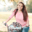 Happy Student Girl With Bicycle — Stock Photo #38845605