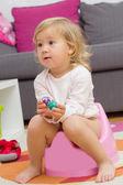 Little girl sitting on the potty — Stock Photo