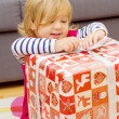 Little Girl Opens Gift — Stock Photo #40477677