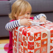 Little Girl Opens Gift — Stock Photo #40478199