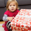 Little Girl with a Christmas Gift — Stock Photo #40478749
