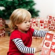Little Girl Opens Gift — Stock Photo #40479221