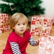 Little Girl Opens Gift — Stock Photo #40479507